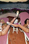 Sienna West and Kelly Madison in stockings from Kelly Madison