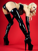 Saffron Taylor wearing a latex animal print bra and hotpants with black latex gloves and stockings