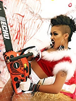 Skin Diamond chopping up with a chainsaw